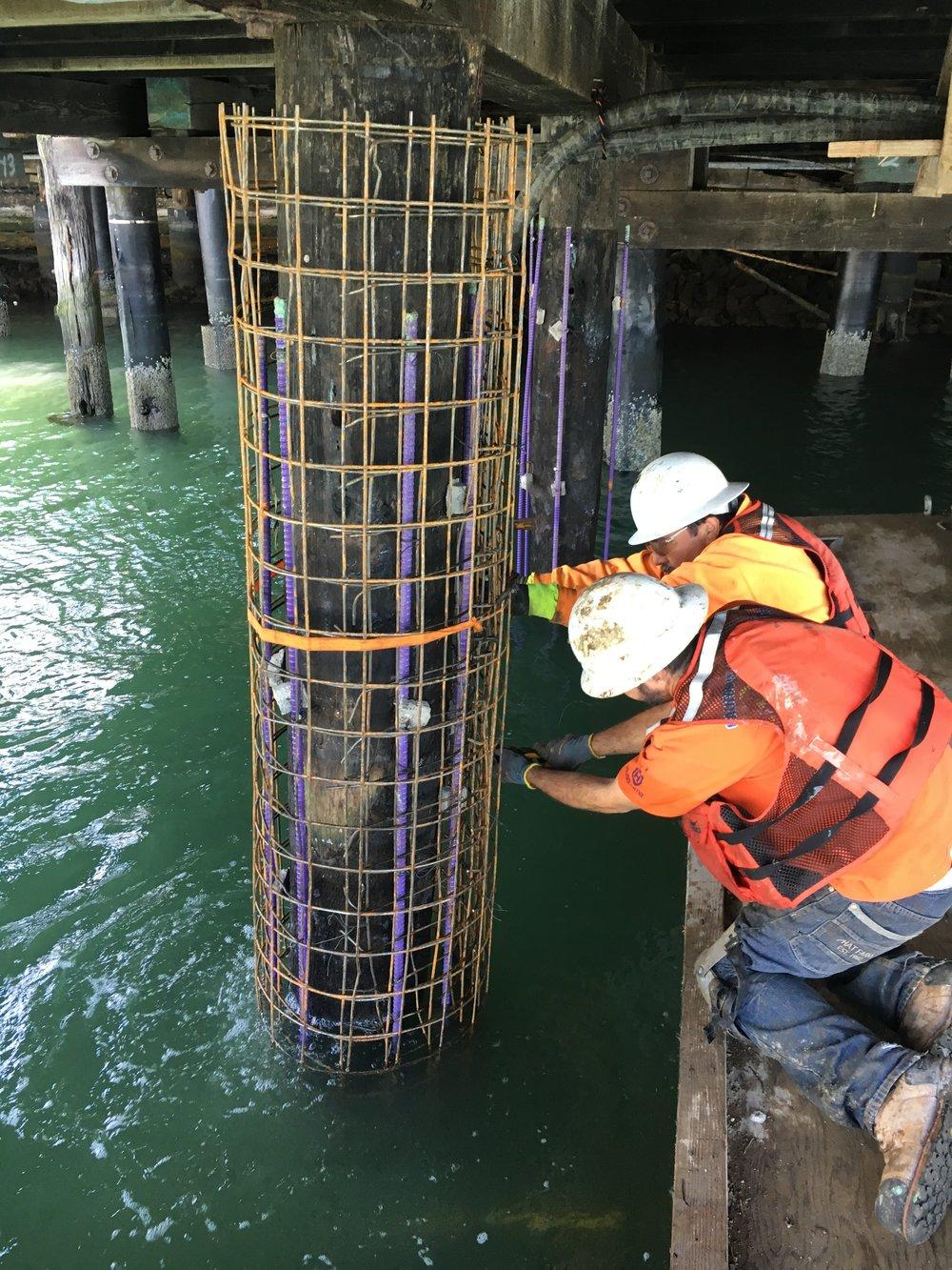 Fiber Reinforced Polymer FRP Underwater pier repair pile jacked.JPG