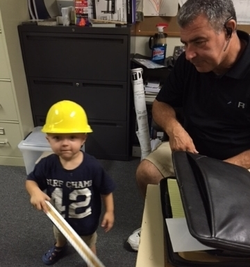 Founder Paul Qualls with one of his grandsons
