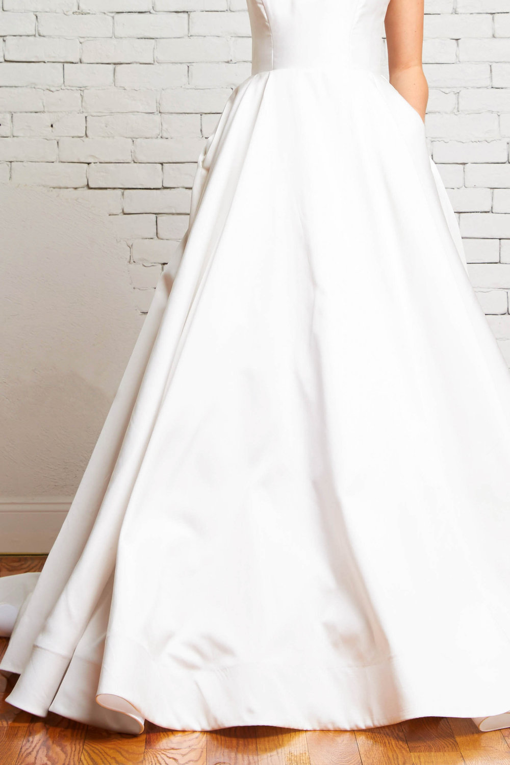 Reese Front-Rebecca Schoneveld_modern_ball_gown_simple_with_pockets_and_buttons.jpg