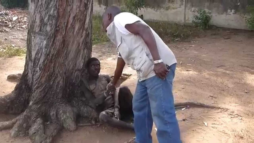 Gregory extends hand to mentally ill man chained to tree.