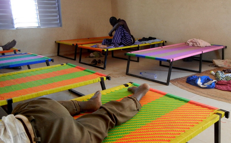 Dorm with beds made by patients