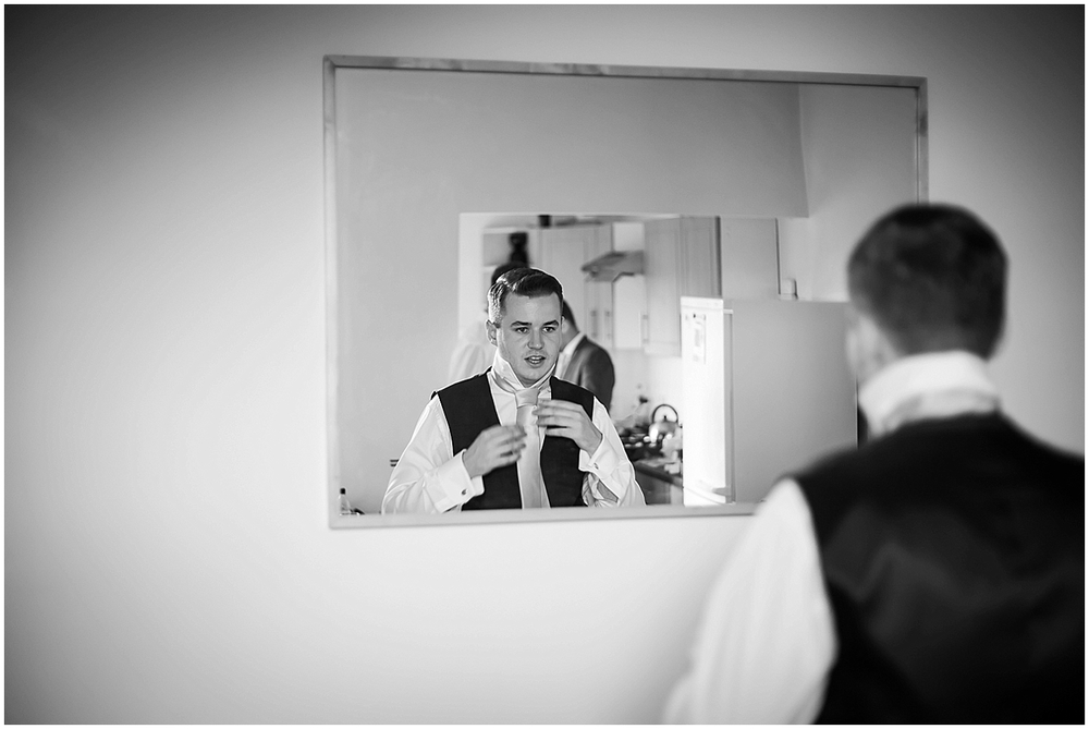 The groom getting ready in the mirror - Sheffield Wedding Photography