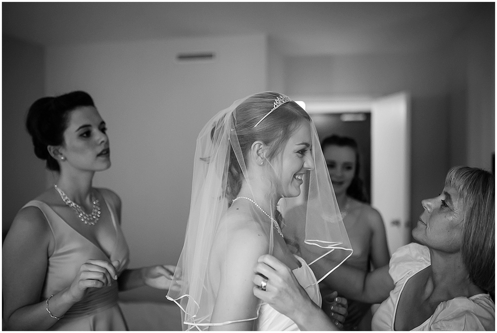 the bride putting on her veil - Sheffield Wedding Photography