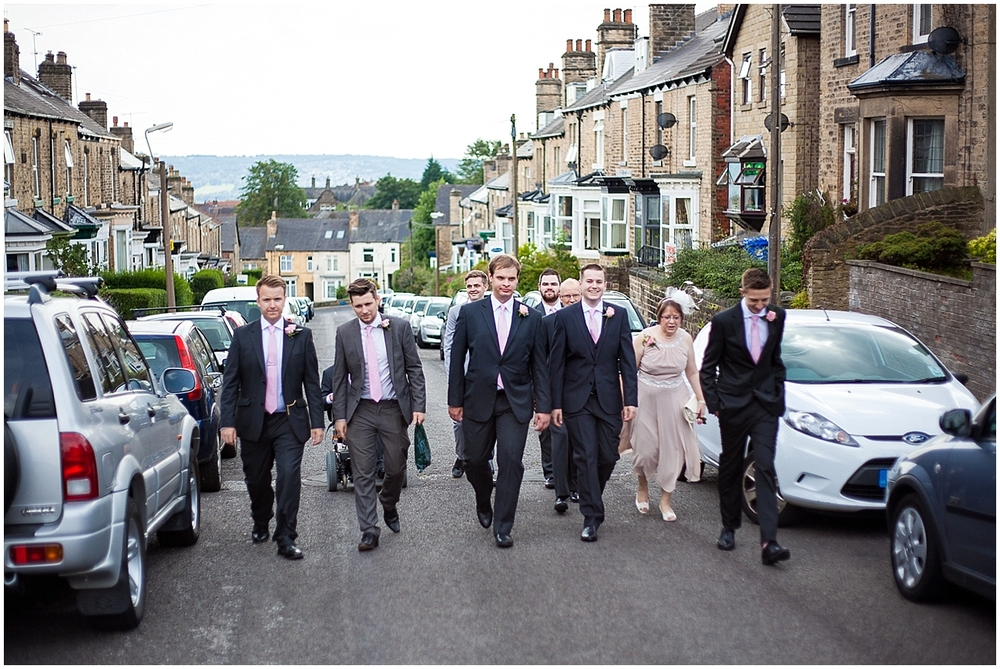 The groom and his groomsmen walking to church - Sheffield Wedding Photography