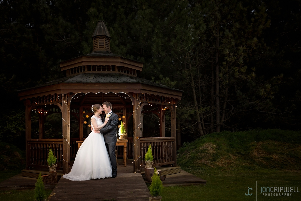 Rosliston Forestry Centre Wedding gazebo in the evening bride and groom