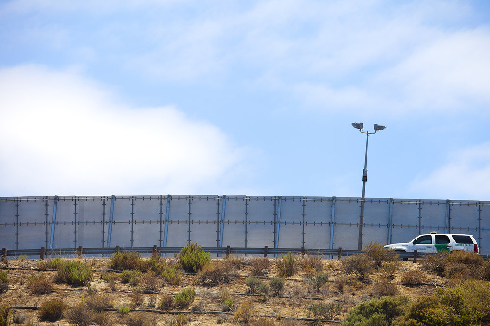 San Diego, California, USA - July 4, 2016: International Border wall between USA -San Diego, and Mexico. Photo: Stella Levi