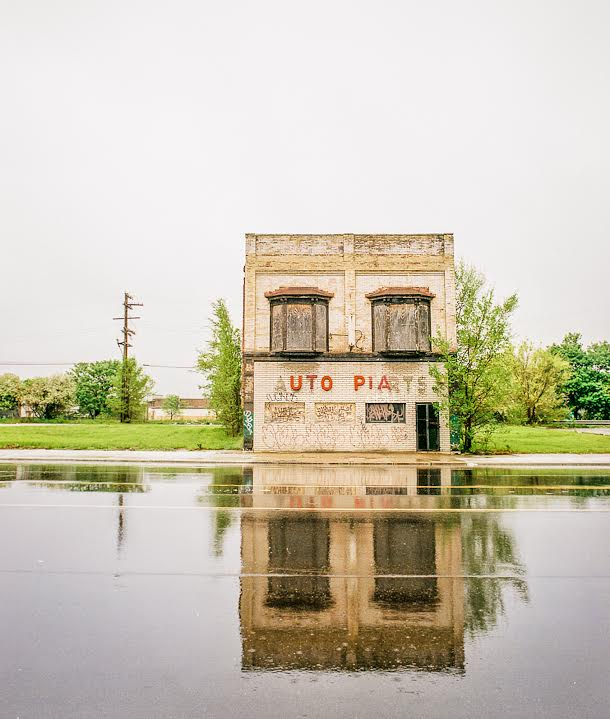 """This image was made in Detroit sometime around 2010 - the building has since been demolished. Whoever changed the wording of the sign from """"Auto parts"""" to Utopia I think sort of captured the irony of the whole city."""