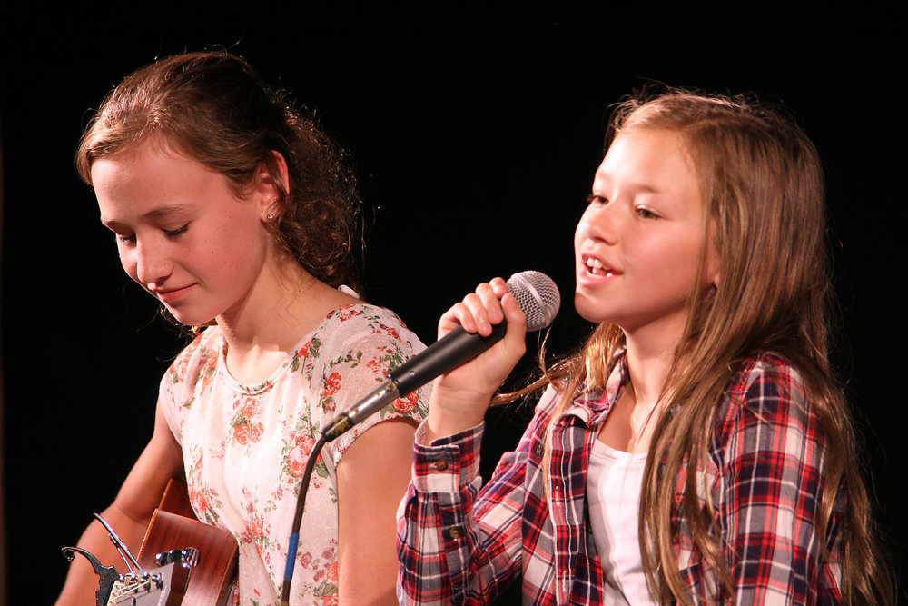 2 girls singing.jpg