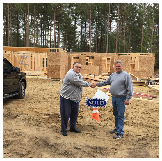 Our customer, Bob (left), with our Project Manager, Joe (right), in front of the framing on Bob's house.