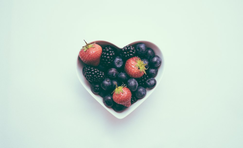 Fruit in heart shaped bowl - integrative medicine
