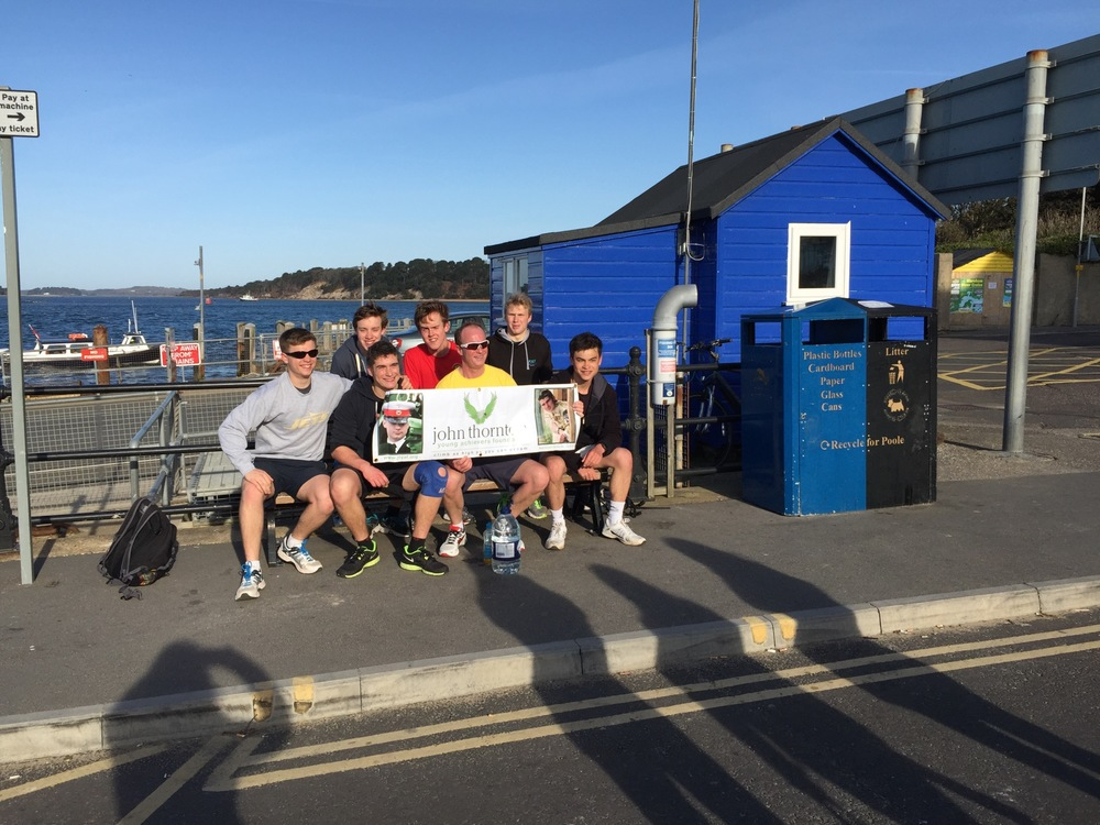 At the ferry, 9.5 miles in, still a team!