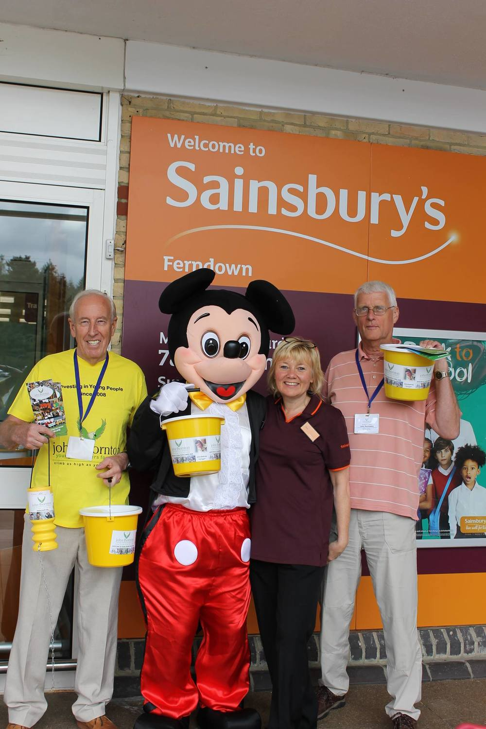 trustee Maurice Pattersonwith mickey, a sainsbury's volunteer and John Nicholson in the peach top