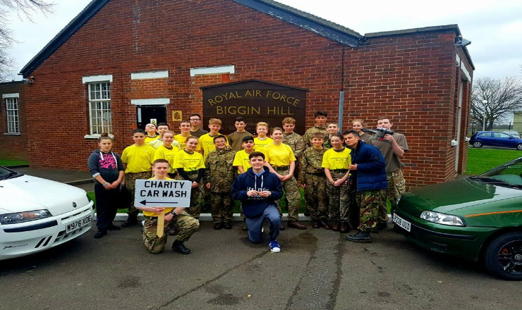 Adam is the cadet holding the sign