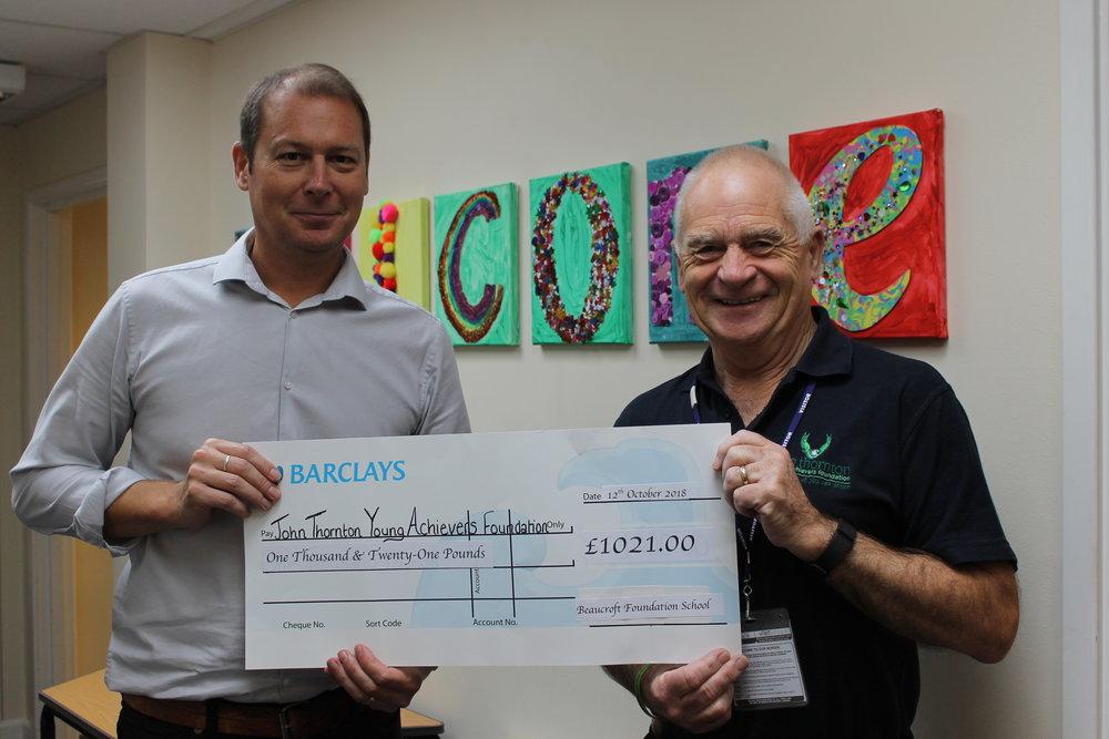 Beaucroft Headteacher Joe Barnett presenting the big cheque to JTYAF Chairman Pete Thornton.