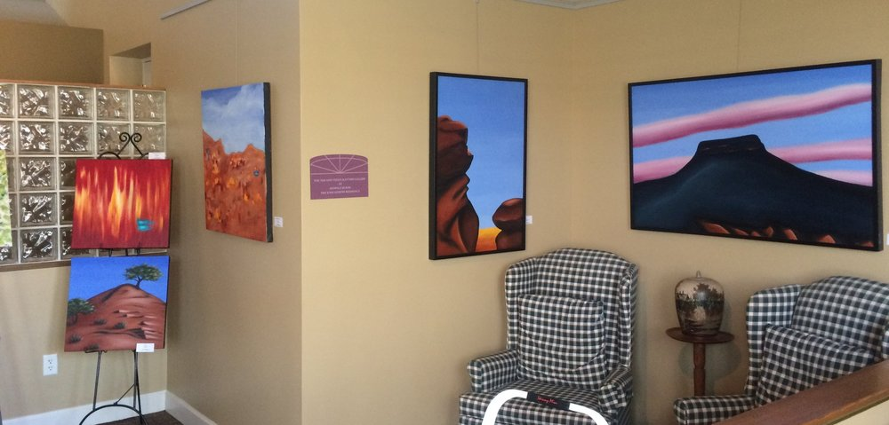 Some of my Southwest-inspired oil paintings on display in the lounge area
