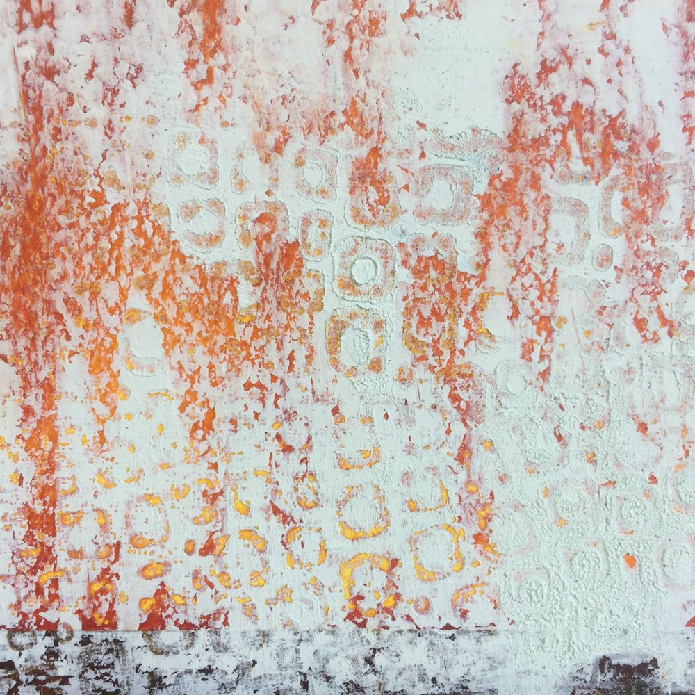 detail shot of painting in progress to show pattern achieved after pressing textured paper into the surface
