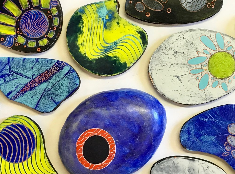 Painted riverstones by Lori Elliott-Bartle.
