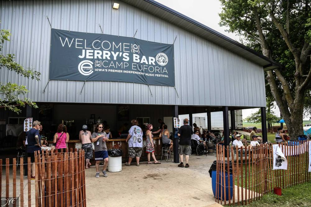 "In 2008 Jerry added his own bar. ""Jerry's Bar"" was made from reclaimed barn lumber. The bar now sits in his open air shed (built in 2013). It has become a marquee location for festival goers throughout the weekend."