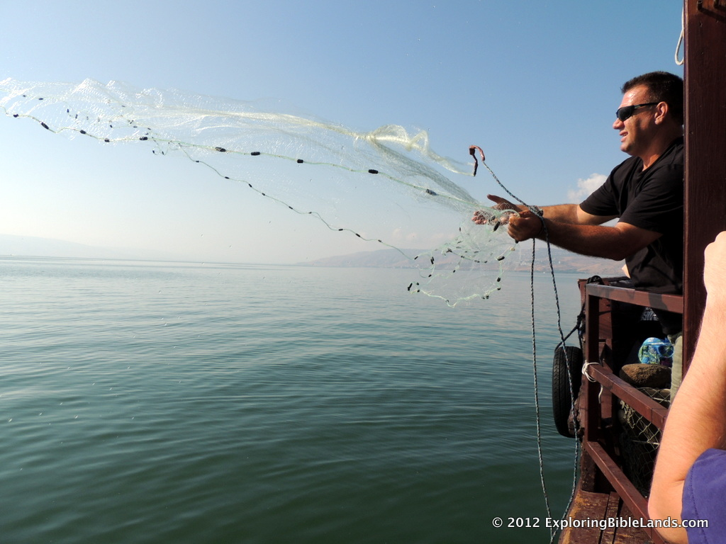 A local fisherman casts his net into the Sea of Galilee.