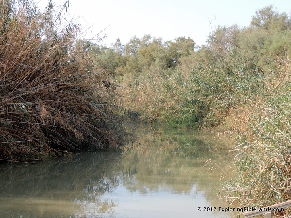Slow water flow of the Jordan River at Qasr al-Yahud.