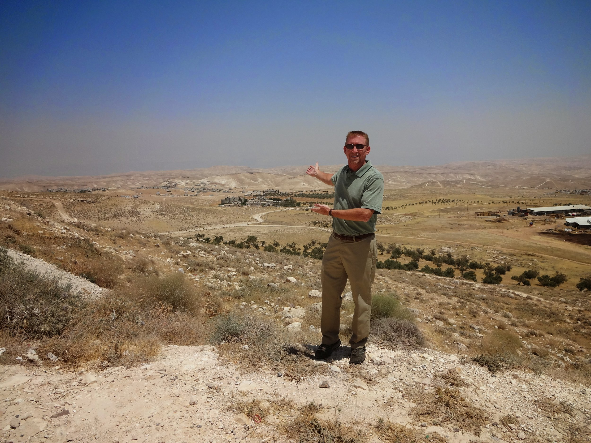Tim Smelser, one of the members of our tour, stands with the Negeb in the background.