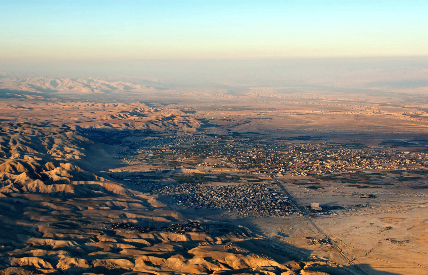 The modern city of Jericho and the wilderness rising to the west. Photo from BiblePlaces.com.