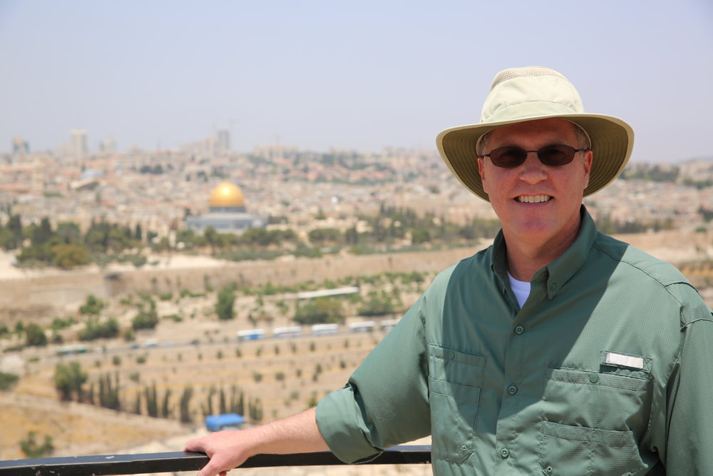 Barry Britnell, standing on the Mount of Olives.