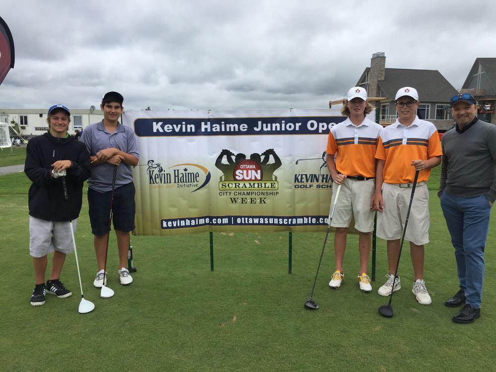 Kevin poses with juniors on the first tee of the Kevin Haime Junior Open.