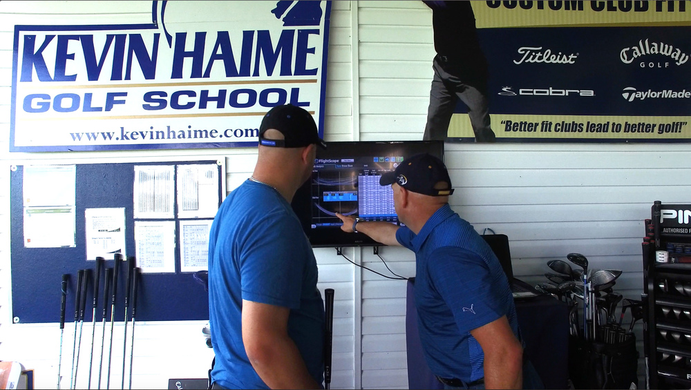 Kevin dissects some FlightScope launch data with a client.