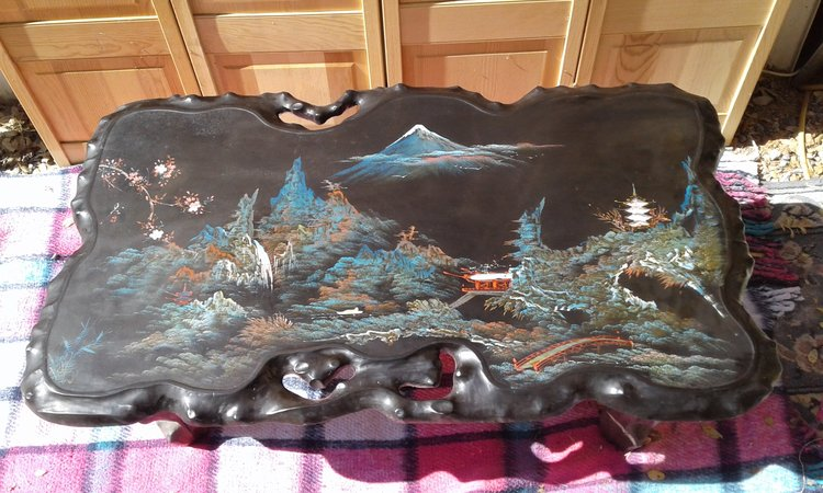 Beautiful Oriental style table.  Black lacquer in color with a gorgeous mother of pearl inlay and painted scene!  $165.00