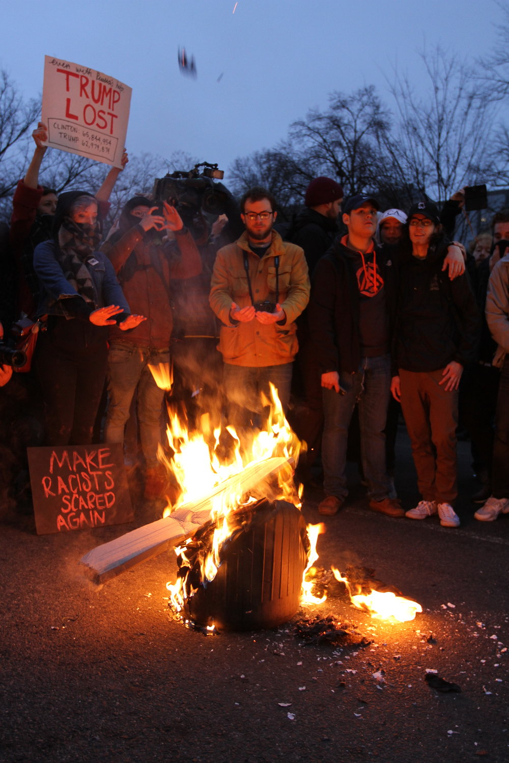 Protestors burn a garbage can on the streets of Washington, DC on the night of the inauguration.