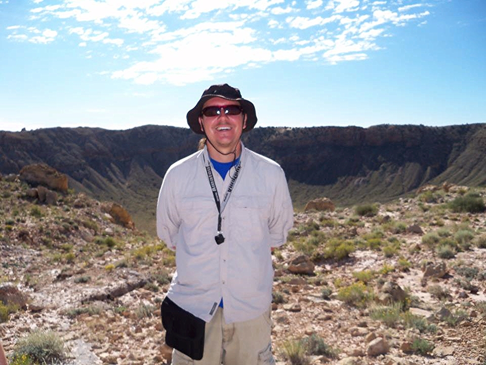 Dr Matthew M. Wielicki investigating the overturned Coconino ejecta layer at Meteor Crater, Arizona.