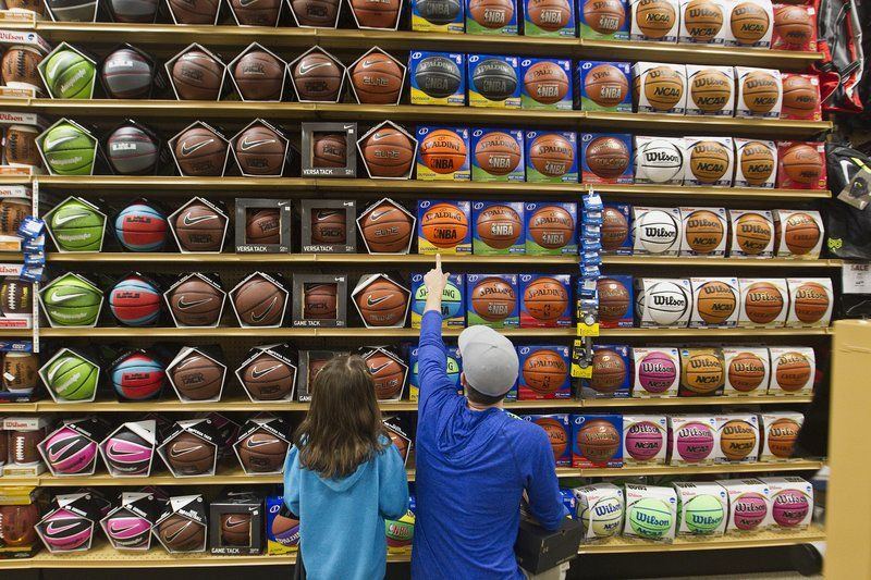 Me and Savannah shopping for basketballs in order to give a KID an assist.  She's my little helper in all this.