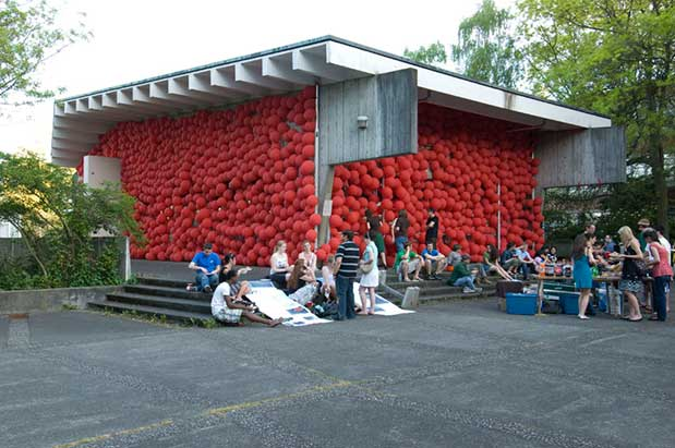 Hot dogs are served at the University of Washington Nuclear Reactor Building, adorned in red balloons.