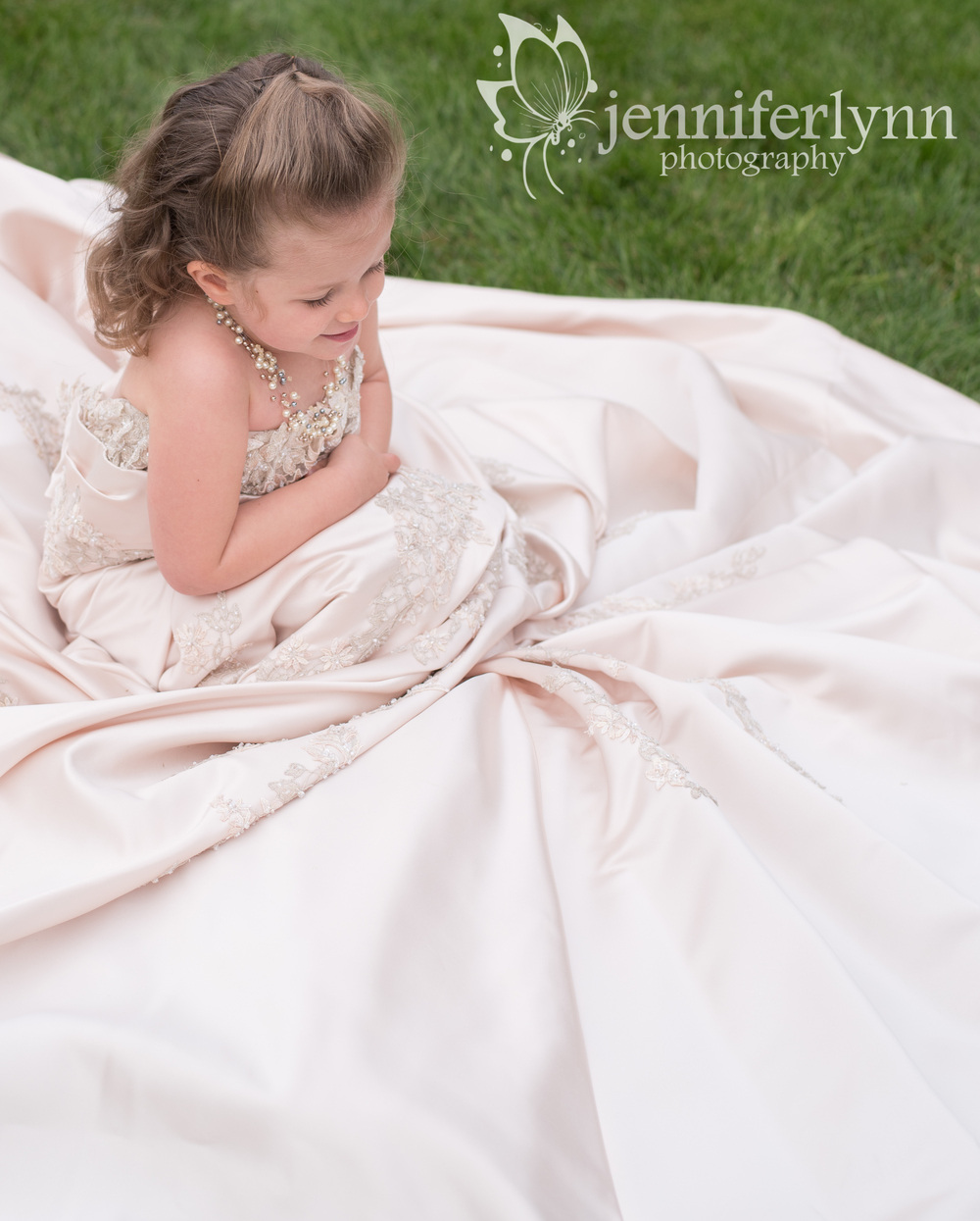 Girl Sitting in Mom's Wedding Dress