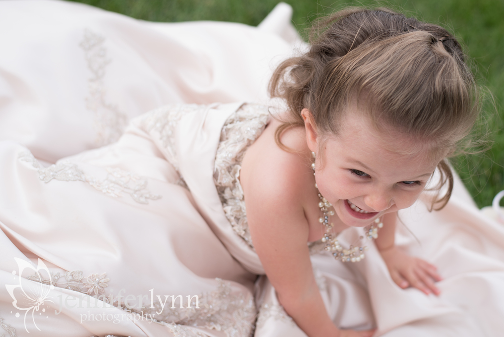 Daughter Playing in Mom's Wedding Dress