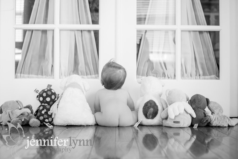 Baby Bottom In Line with Stuffed Animals