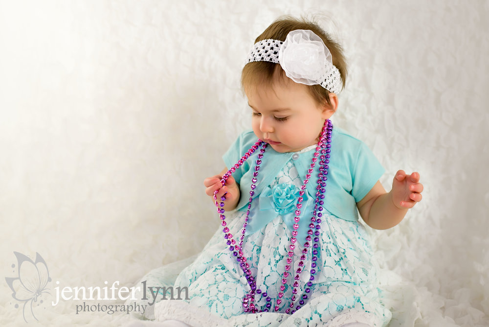 Baby Girl Sitting with Pearl Beads