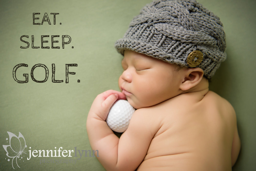 Newborn Boy Holding Golf Ball