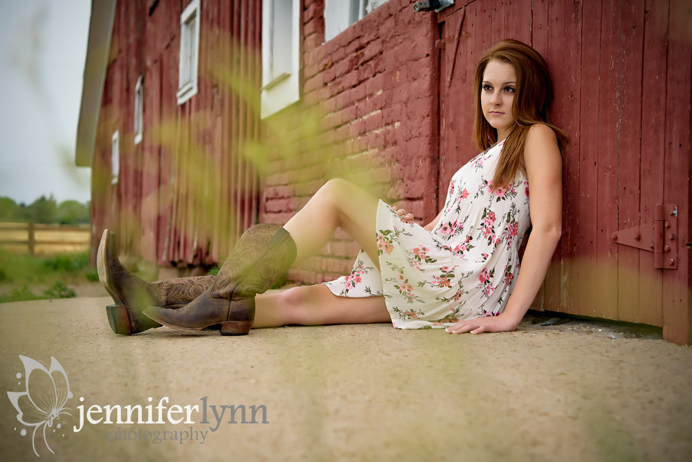 Senior Girl Sitting Red Barn