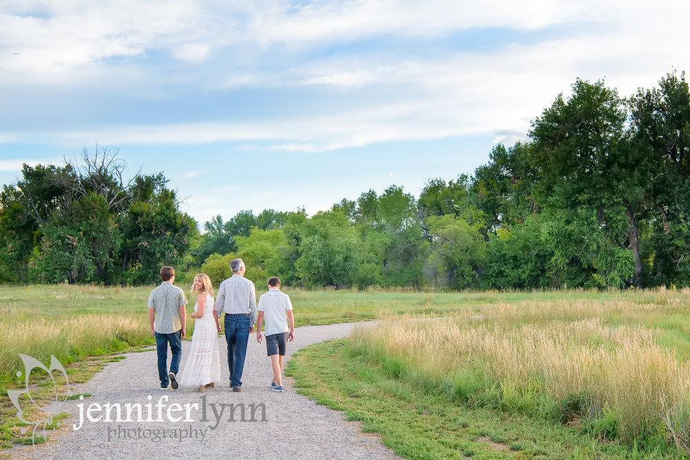 Family Walking Along Gravel Road