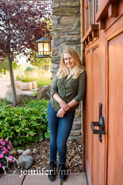 Senior Girl Leaning Rustic Wooden Door