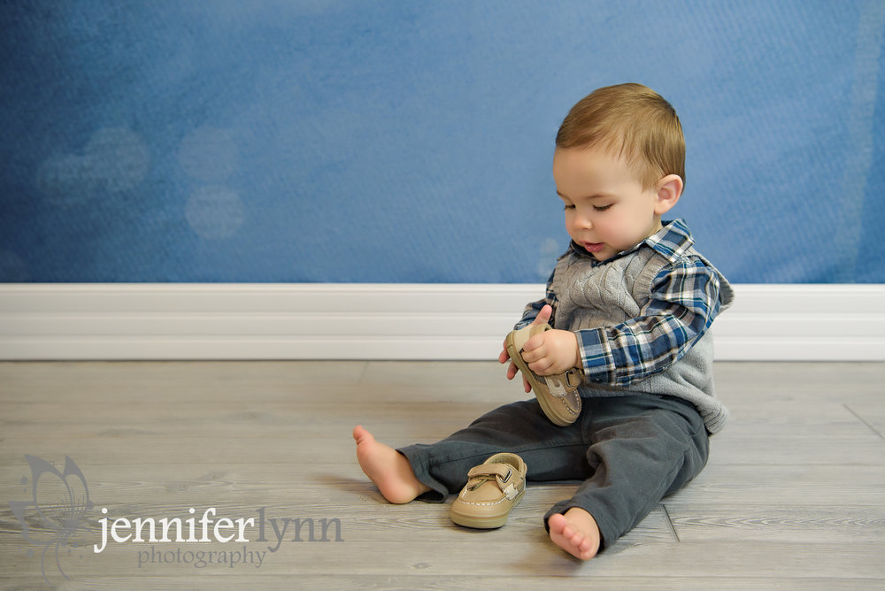 Baby Boy Sitting Looking at Shoe