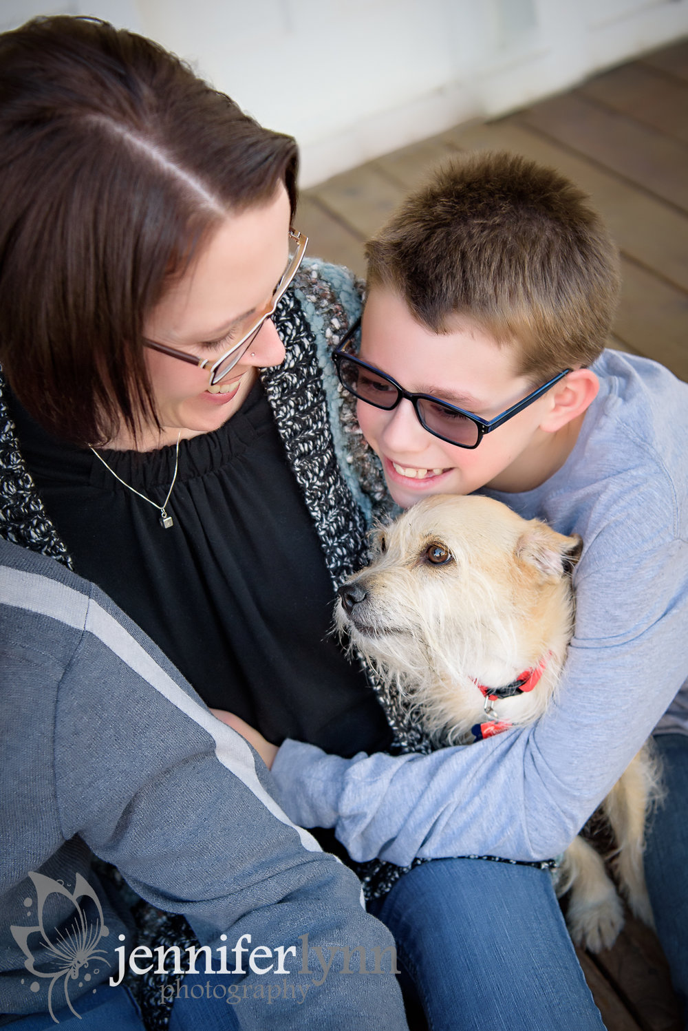 Mom and Youngest Son Share a Hug with Dog