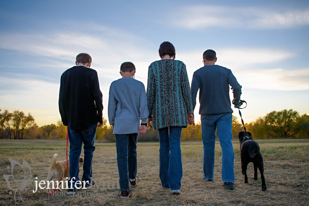 Family and Dogs Walking Into the Sunset