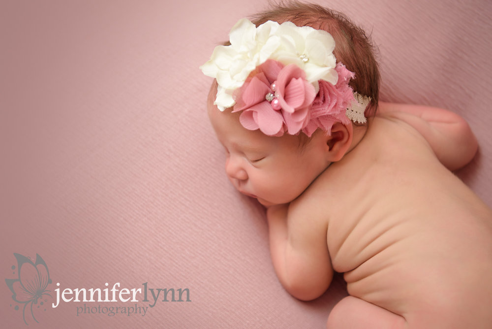 Newborn Girl Curled on Tummy Pink Blush Fabric