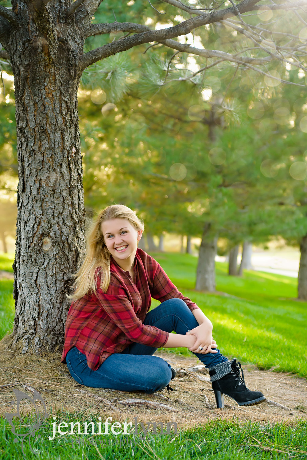 Senior Girl Sits Next to Tree Boots Fall