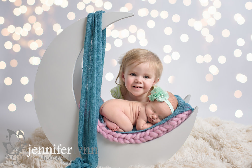 Sister Newborn Photo with Moon Prop