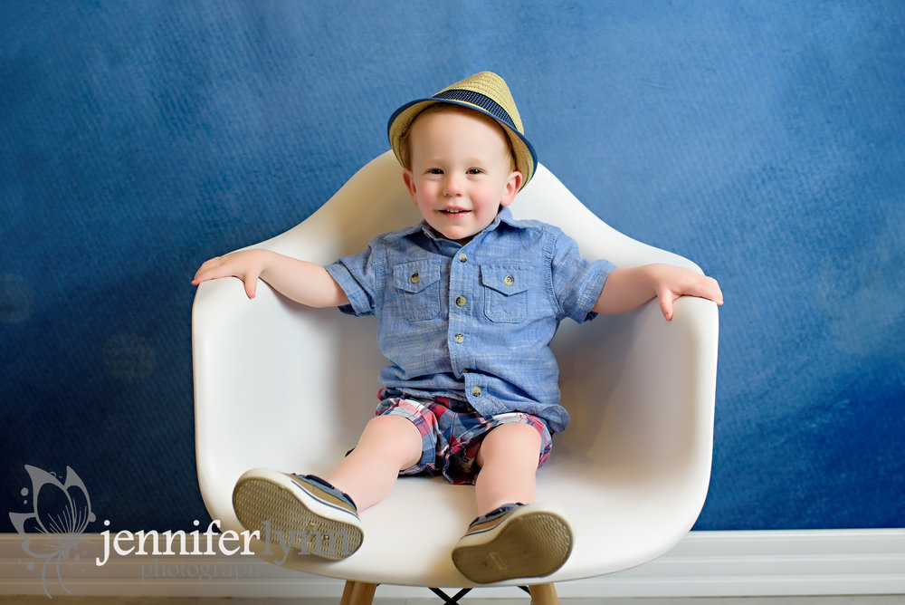 Toddler Sitting White Chair and Denium Colors