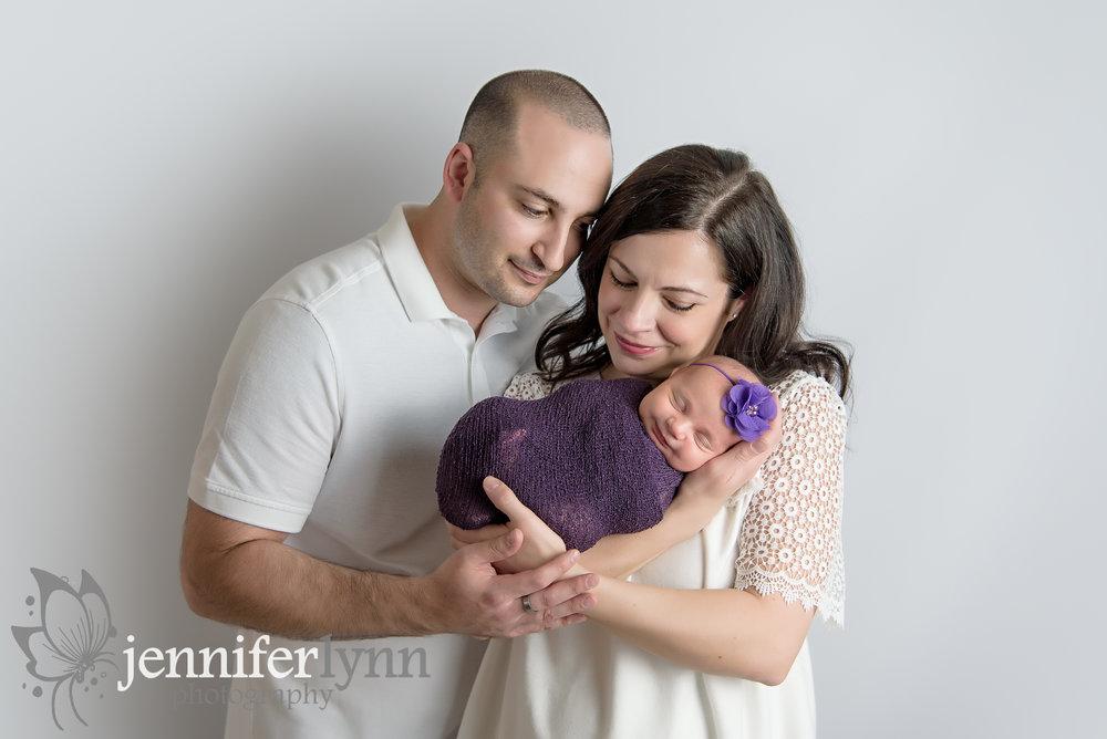 Parent Newborn Purple Gazing Down
